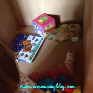 Cardboard box den for toddlers