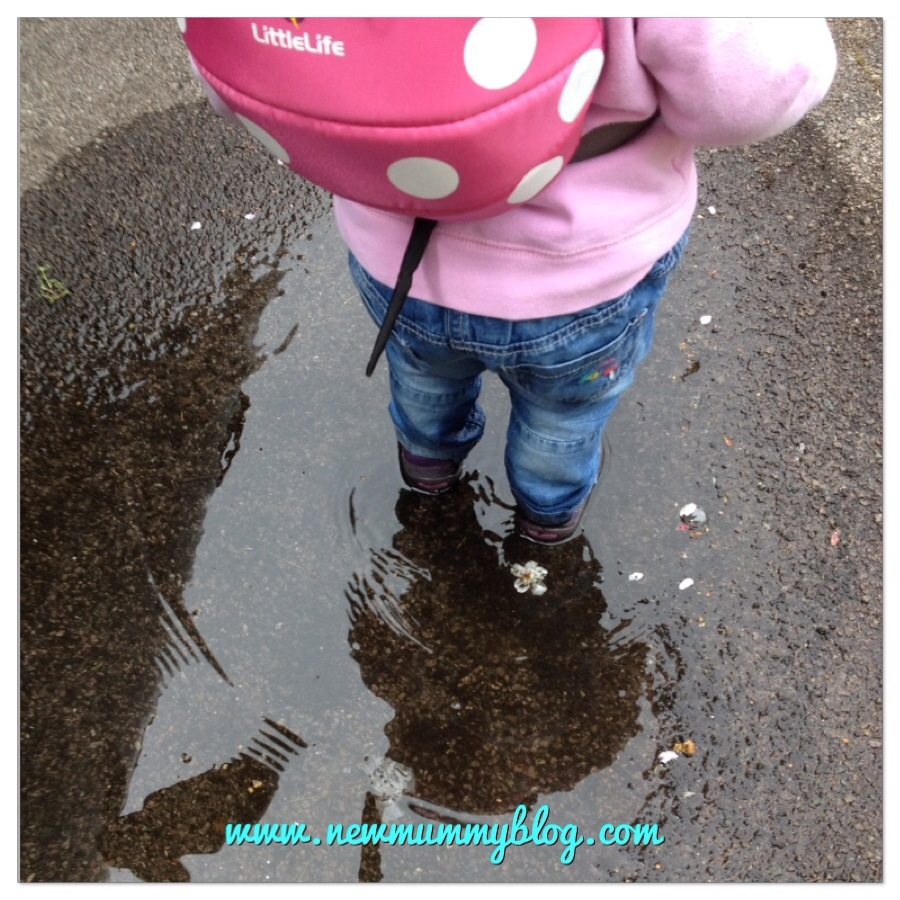 16 month old toddler splashing in puddles