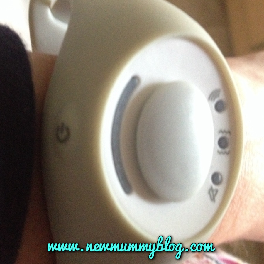 The button on the left turns on the Babble Band baby monitor watch