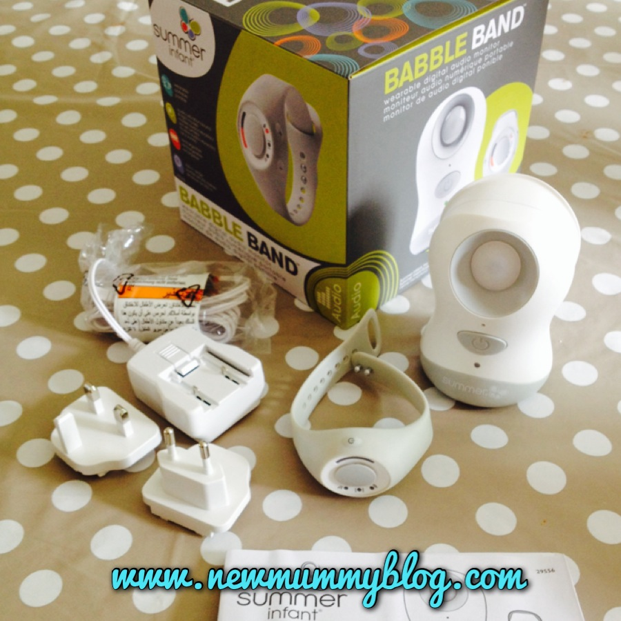 the contents of the babble band box, charger, European plug, base unit, watch receiver, box and instructions
