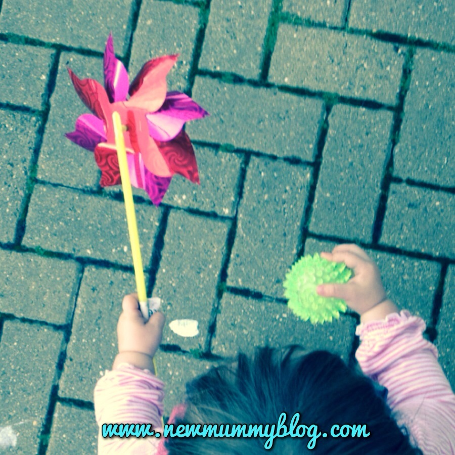 #MySundayPhoto. toddler with windmill and spikey ball  going shopping