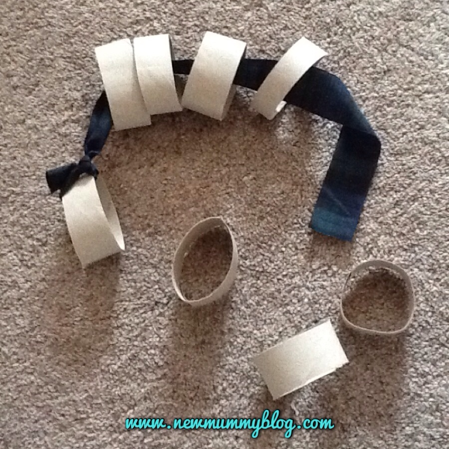 Make a ribbon and cardboard tube threading toy