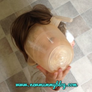 toddler with a jug on her head