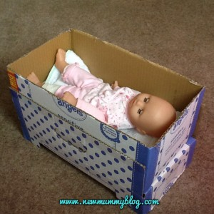 Make a doll's bed from a cardboard box