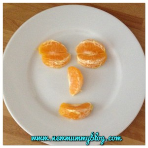 a face made from orange segments