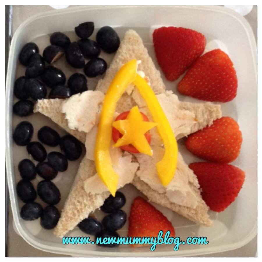 captain america theme healthy lunch blueberries strawberries star surround a star sandwich