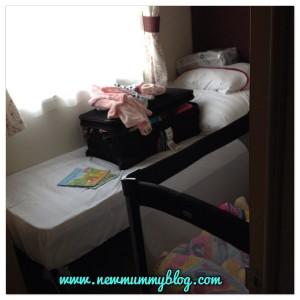 Fitting a travel cot into a caravan bedroom