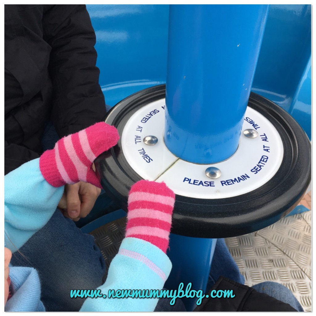 Toddler H spinning the clouds ride at Peppa Pig World in Southampton - our family day out with two year old Toddler H