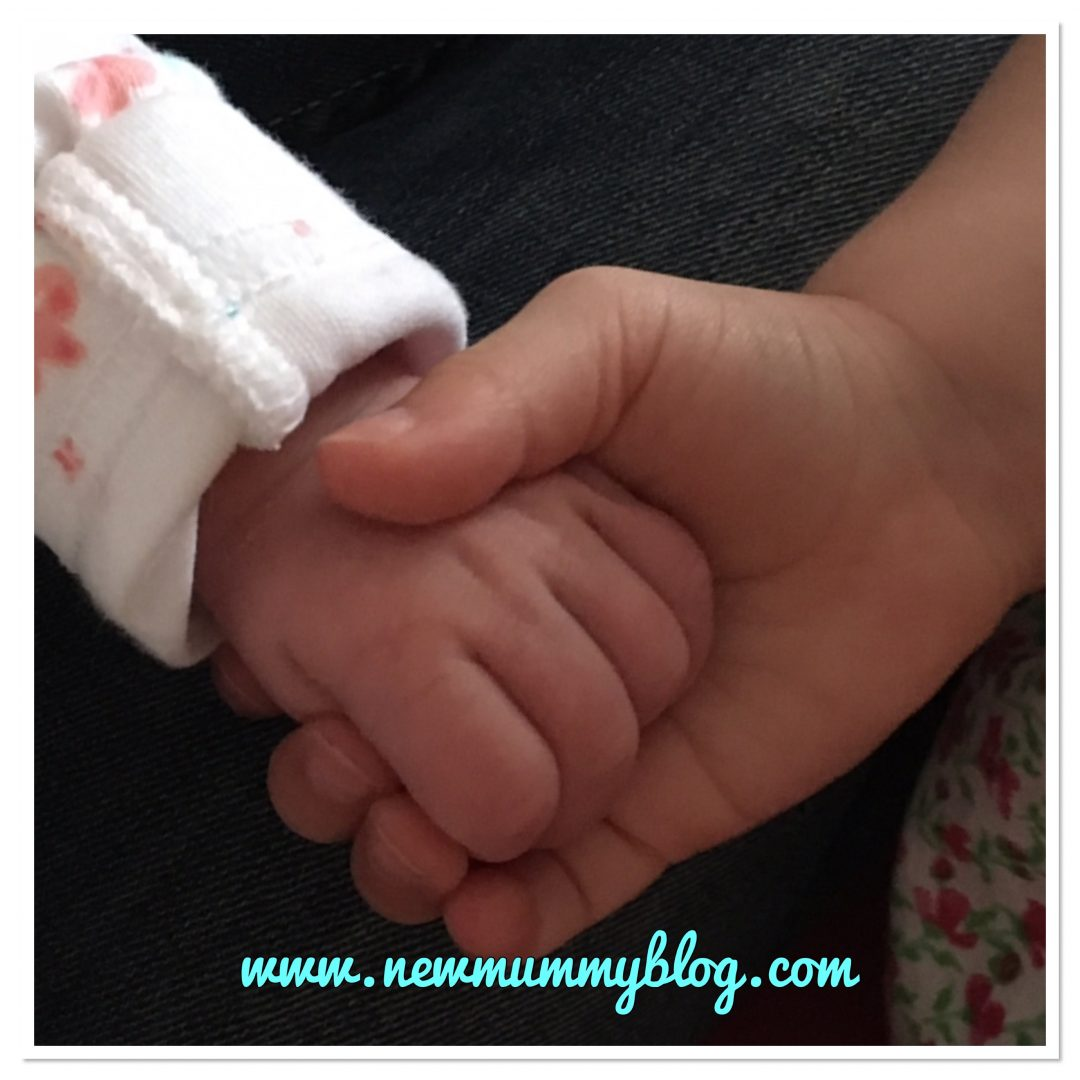Siblings holding hands newborn and toddler NewMummyBlog