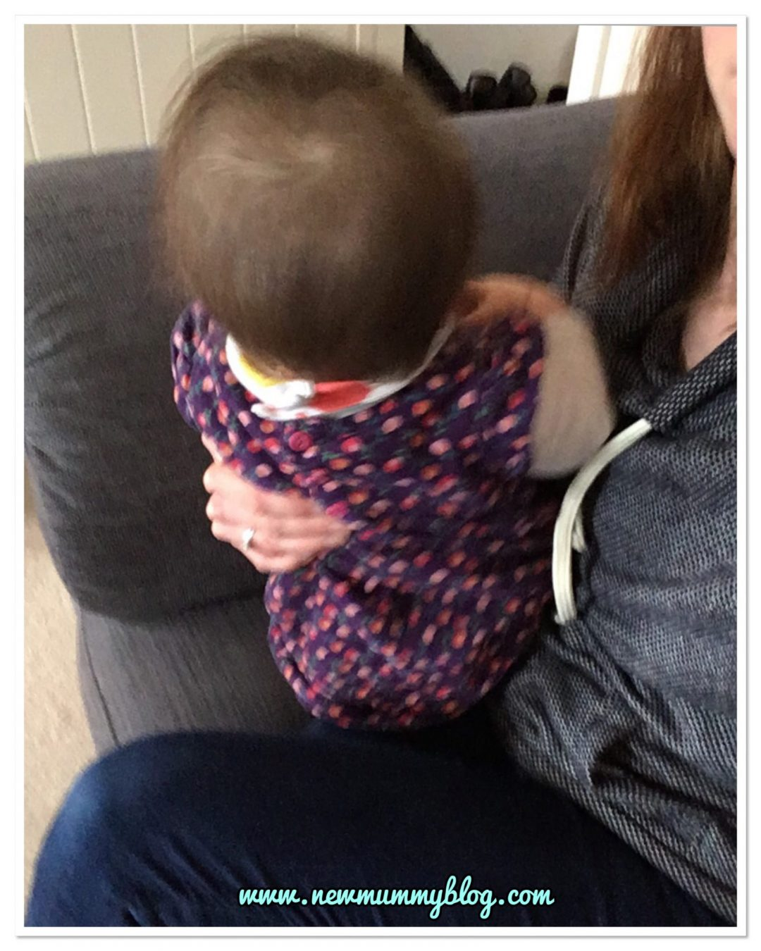 Baby distracted by a noise during breastfeeding. Sittingbolt upright. The challenge of feeding a 9 month old who sits, crawls and wants to be involved!