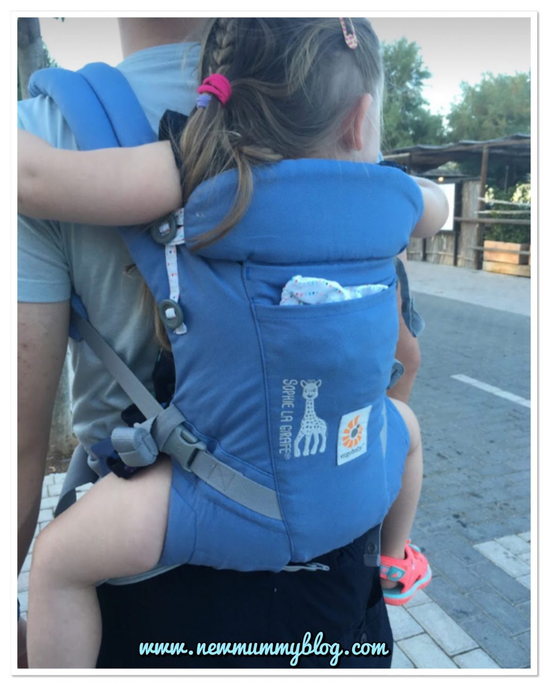 Ergobaby Adapt carrier with Toddler H almost age 3 on holiday in Majorca - showing the ergonomic 'M' shape that the Ergobaby carriers create - the safe way to carry a baby and toddler - up to age 4, it's still comfy