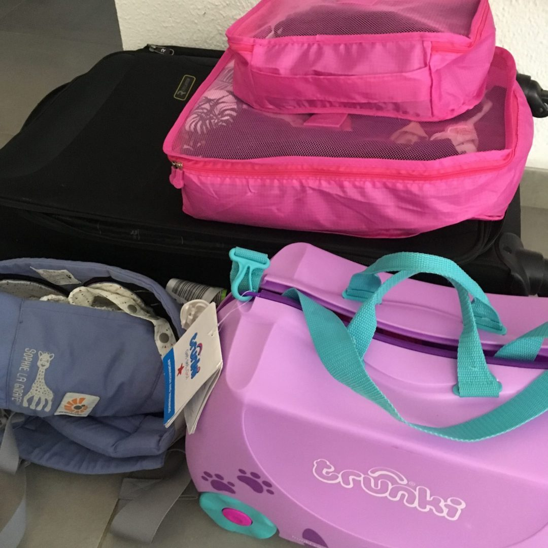 Flying with kids tips for packing - Packing cubes, trunki, baby carrier - packing for family holiday to Ibiza - organized packing for family of four - one year old baby and 3 year old preschooler
