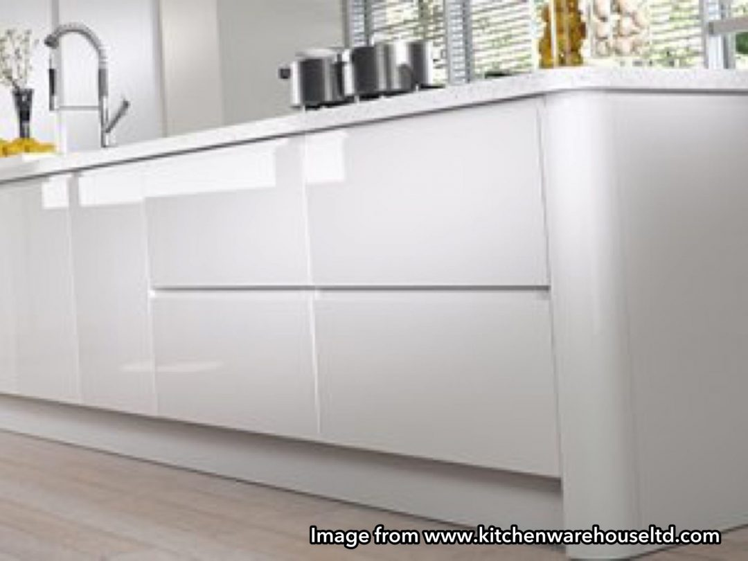 Image from Kitchen Warehouse Ltd glossy handleless kitchen