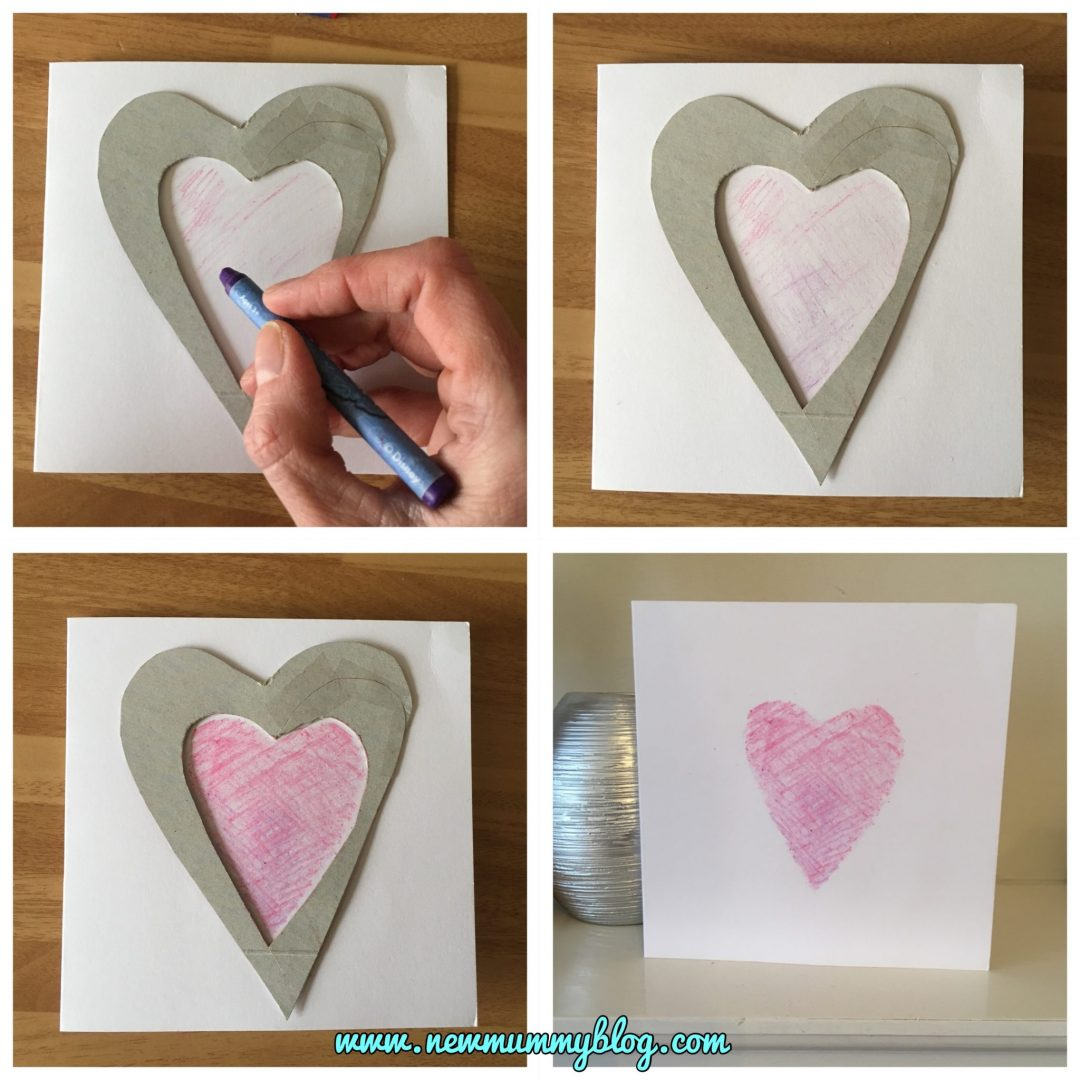 Mummy making a Valentine's Day card using the toddler's cardboard heart stencil