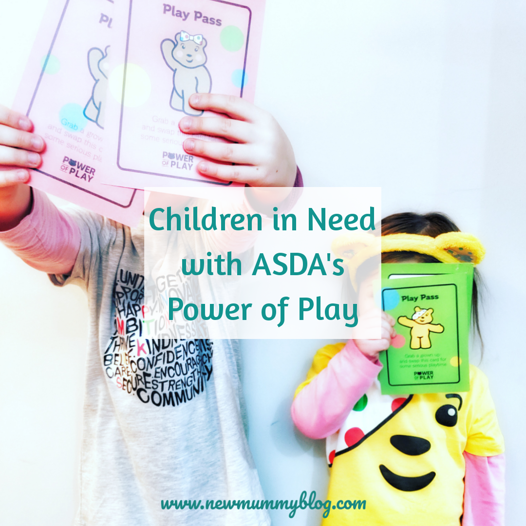 Girls in Asda Children in Need tops and headbands show the Asda Power of Play playing cards 2019
